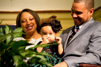 The Bostons affectionately look at their daughter, Riley.  (Official Berean SDA Church Photo by Burdie Henri)