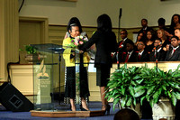 Dacia LaDonis presents a bouquet of flowers to Xernona Clayton
