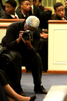 Burdie Henri,  of Berean's photography ministry, takes a photo of Urick LaDonis as Dr. Carton P. Byrd speaks
