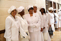 Deaconesses with their new uniform hats.